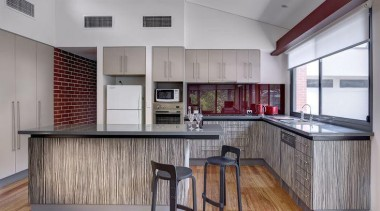 From Laminex Australia's Project of the Year (Studio cabinetry, countertop, floor, flooring, hardwood, interior design, kitchen, real estate, wood flooring, gray