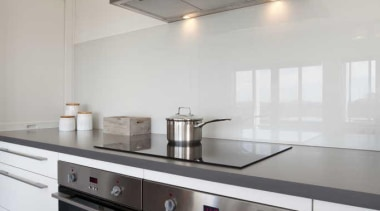 White kitchen with a glossy wall - Kitchen cabinetry, ceiling, countertop, cuisine classique, home appliance, interior design, kitchen, kitchen appliance, kitchen stove, gray