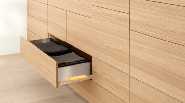 134 One topic. Three applications. Four motion technologies.Infinite cabinetry, chest of drawers, drawer, floor, flooring, furniture, hardwood, laminate flooring, plywood, product, product design, sideboard, tile, wall, wood, wood flooring, wood stain, orange