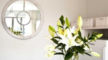 White nuance kitchen - Kitchen at Beach Apartment ceiling, chandelier, cut flowers, dining room, floral design, floristry, flower, flower arranging, home, interior design, light fixture, lighting, room, table, vase, gray