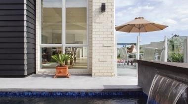The perfect showcase of bricks versatility. Designed to architecture, building, home, house, property, real estate, reflection, residential area, swimming pool, water, window, black, gray, white