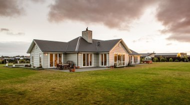 Set in a superb new Canterbury subdivision this cloud, cottage, estate, farm, farmhouse, grass, home, house, landscape, property, real estate, residential area, roof, rural area, sky, suburb, brown, white