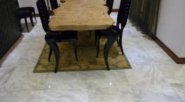 Bernini silver semi-polished dining room floor tile. chair, floor, flooring, furniture, hardwood, table, tile, wood flooring, wood stain, gray