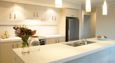 For more information, please visit www.gjgardner.co.nz countertop, interior design, kitchen, property, real estate, room, yellow, orange