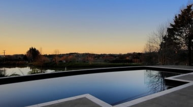 Concrete swimming pool dusk shot - private residence architecture, estate, home, house, lighting, property, real estate, reflecting pool, reflection, residential area, roof, sky, swimming pool, water, black