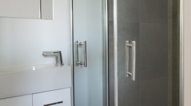 Batwing shower doors in the spare bathroom open bathroom, door, floor, glass, interior design, plumbing fixture, room, shower, gray