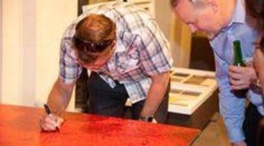 At Auckland Museum - At Auckland Museum - flooring, senior citizen, table, orange, red