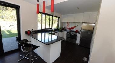 Kitchen design features red hot chilli splash back. interior design, property, real estate, room, gray, black