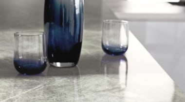 Warm and inviting, Soapstone Sequoia hasfinely drawn veins floor, flooring, furniture, glass, glass bottle, product design, table, tap, vase, gray