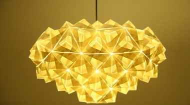 A range of folded metallic fabrics  are lampshade, light fixture, lighting, lighting accessory, origami, origami paper, product design, symmetry, yellow, brown, orange