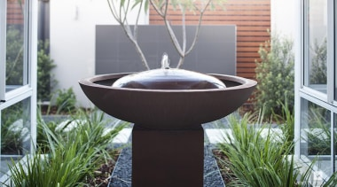 Make a statement with a water feature. - bird bath, flowerpot, water feature, white