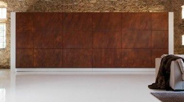 An imposing wall of weathered corten steel one door, floor, flooring, furniture, hardwood, interior design, wall, wood, wood stain, brown, gray