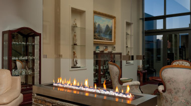 The idea of using natural stone inside may fireplace, flooring, hearth, interior design, living room, brown