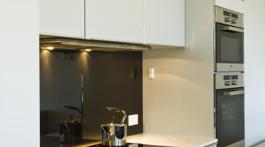 New Zealand Apartment Kitchen Designer of the Year cabinetry, countertop, interior design, kitchen, product design, under cabinet lighting, white