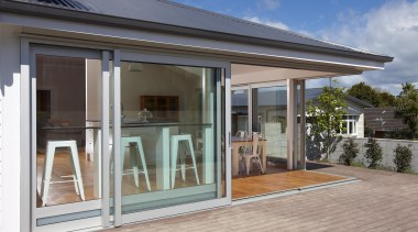 Create a real architectural look with the appearance door, facade, house, orangery, property, real estate, window, gray