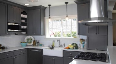 The incredible popularity of the color gray for cabinetry, countertop, cuisine classique, home appliance, interior design, kitchen, room, black, gray