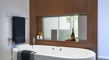This master suite features standing cabinetry as a bathroom, interior design, room, gray