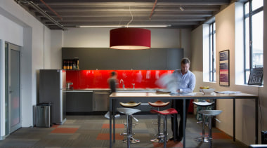 Red accents in the splashback, light shades, carpet furniture, interior design, office, table, black, gray