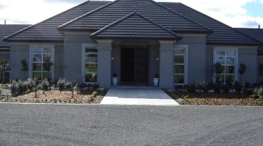 Generously proportioned plaster home built in Canterbury by asphalt, cottage, elevation, estate, facade, home, house, property, real estate, residential area, roof, siding, suburb, window, gray, black