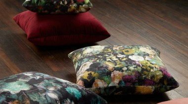 Flowerbomb features a majestic, ethereal bouquet of peonies, cushion, textile, black