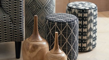 Exotic and eclectic yet effortlessly relaxed, ADITI is ceramic, furniture, table, vase, brown