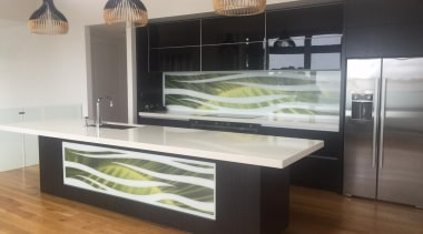 Colourful glass splashbacks create a dynamic backdrop in countertop, furniture, glass, kitchen, gray