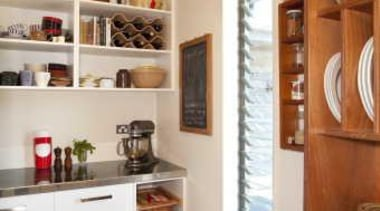 Kitchen with white cupboards, grey flooring and wooden cabinetry, furniture, interior design, kitchen, room, shelf, shelving, gray, brown