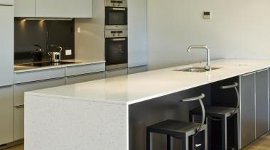 New Zealand Apartment Kitchen Designer of the Year cabinetry, countertop, cuisine classique, floor, flooring, hardwood, interior design, kitchen, laminate flooring, product design, real estate, wood flooring, orange, gray