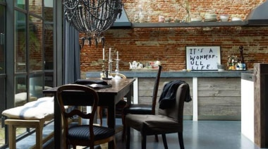 Red bricks + Luxurious Chandelier + Concrete = architecture, chair, dining room, furniture, interior design, table, black, gray