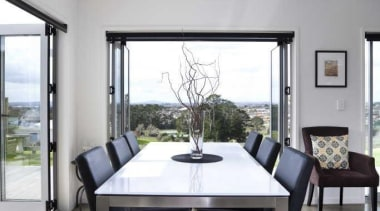 Dining room overseeing the city - White Interior floor, furniture, interior design, living room, real estate, table, window, gray