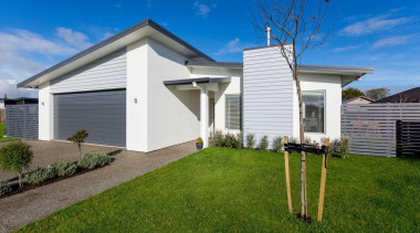 Two new homes by Fowler Homes Manawatu take cottage, elevation, estate, facade, grass, home, house, land lot, property, real estate, residential area, siding, sky, yard, brown