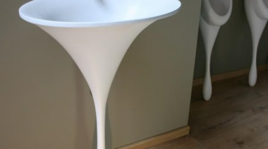 This organic form is the solid resin 'spoon bathroom sink, ceramic, plumbing fixture, product design, sink, tap, gray, brown