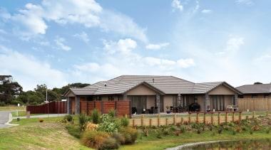 Presenting Austral Bricks® Designa Schist - an innovative cottage, estate, facade, farmhouse, home, house, land lot, landscape, property, real estate, residential area, roof, sky, suburb, white
