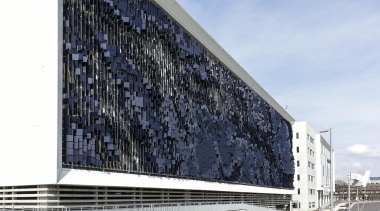 This display on the parking structure at Eskenazi architecture, building, commercial building, corporate headquarters, facade, headquarters, sky, structure, white, black