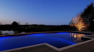 Well balanced lighting give this concrete pool a blue, estate, evening, home, house, landscape lighting, leisure, light, lighting, plant, property, real estate, reflection, residential area, sky, swimming pool, water, blue, black