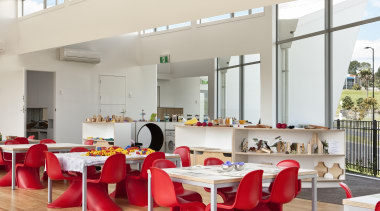 Preschool classroom - red chairs accent the white furniture, interior design, restaurant, table, gray