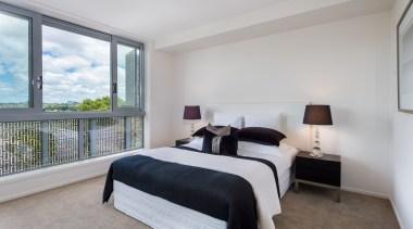 Bedroom with ensuite bathroom bed frame, bedroom, estate, home, interior design, property, real estate, room, window, gray