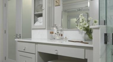 We reconfigured this Master Bathroom to be a bathroom, bathroom accessory, bathroom cabinet, cabinetry, countertop, cuisine classique, floor, home, interior design, room, sink, gray