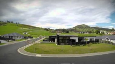 This episode will land you in Mosgiel, just asphalt, land lot, property, real estate, residential area, road, sky, suburb, black, white
