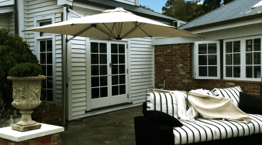 Riviera Cantilever Umbrella - backyard | home | backyard, home, house, outdoor structure, patio, porch, real estate, siding, window, yard, brown