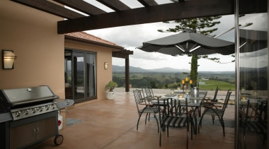 Outdoor living and dining area with landscape view house, interior design, patio, property, real estate, black
