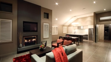 Family dining and living area with fireplace in ceiling, home, interior design, living room, real estate, room, black, brown