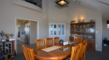 Dining area for families in Te Anau - dining room, home, interior design, living room, property, real estate, room, table, gray