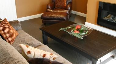 Orange family lounge in Temuka - Landmark Temuka floor, flooring, furniture, home, interior design, living room, room, table, brown