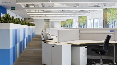 The Birch tree graphics adorn pillars at DNV desk, furniture, office, gray