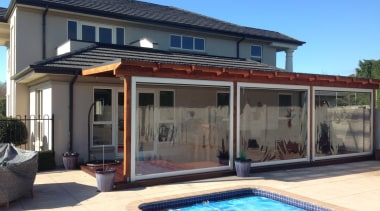 The Calido Zip Outdoor Screen by Johnson & house, property, real estate, swimming pool, villa, window, teal