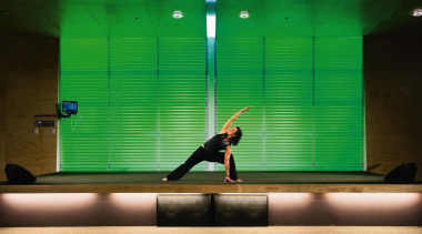 In the Group Fitness studio, the Turbosound TCS entertainment, fun, games, green, indoor games and sports, light, performance, performance art, performing arts, recreation, stage, green