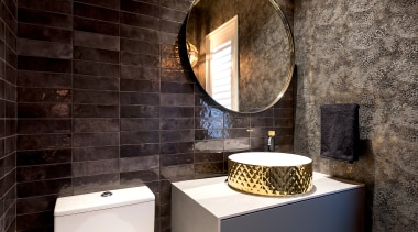 The challenge for this powder room was to