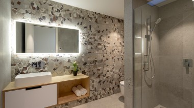 Large-scale terrazzo style tiles and a warm ply