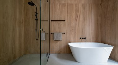 With a pared-back palette of large, timber-look tiles
